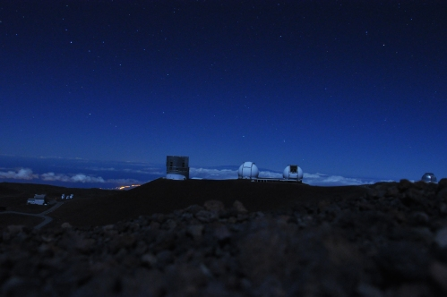 Just after sunset you can still see the observatories. The distant lights are the Kohala Coast.